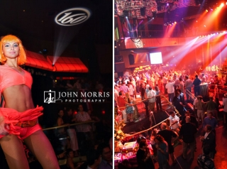 Dancers perform while attendees enjoy a corporate networking event with a nightclub vibe.