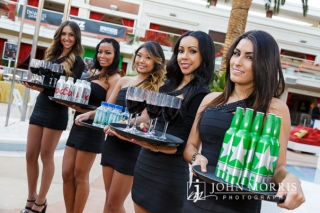 Cocktail waitresses lined up and ready to greet attendees with wine and beer at an outdoor networking event at the Encore Beach Club in Las Vegas.