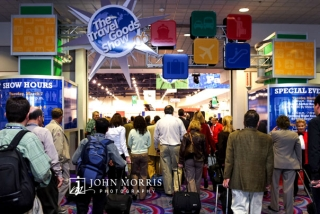 Eager attendees stream into the opening of the exhibit hall during The Travel Goods Show in Las Vegas.