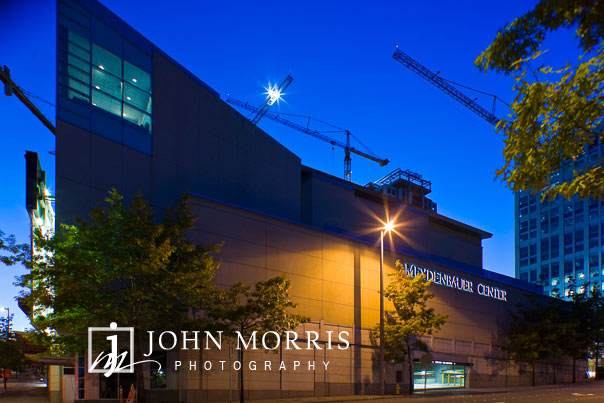 View of the Meydenbauer Event Center in Seattle, Washington at Dusk with construction cranes in the background during a corporate event