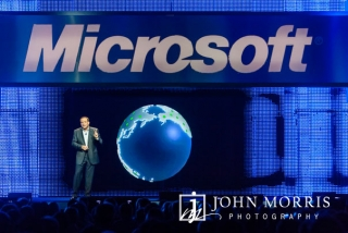CEO presentation during a keynote speech at a corporate event with a hologram of the world created on stage