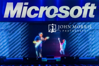 Hologram of BB King performing on stage with a live guitar prodigy during a keynote at a corporate event in Seattle