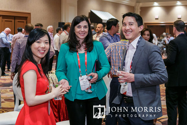 Event attendees smiling and posing for the camera at a networking event during a corporate event at the Mandalay Bay Convention Center in Las Vegas