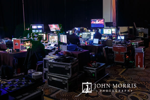 Behind the scenes photograph of the production control room for a large stage event for a opening general session for a corporate event at the Mandalay Bay Convention Center in Las Vegas