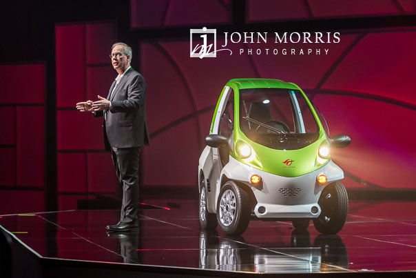 Close up image of a CEO giving opening remarks with a small electric car on stage during a general session during a corporate event at the Mandalay Bay Convention Center in Las Vegas