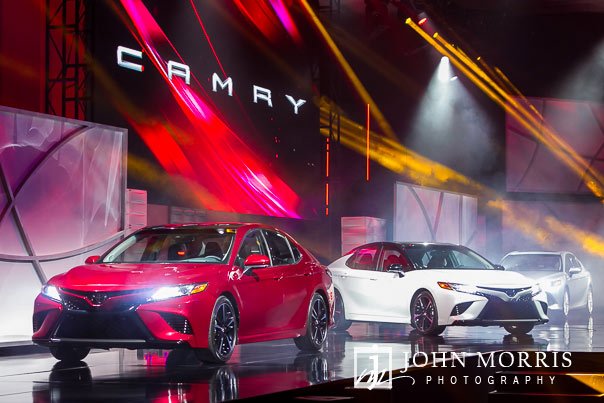 Elaborate stage presentation with three full size cars revealed to an audience of business owners at a general session during a corporate event at the Mandalay Bay Convention Center in Las Vegas