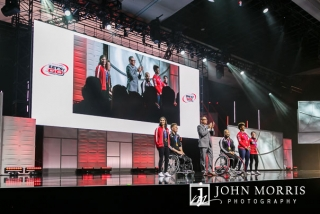 Mid range stage image of Olympians during a motivation segment of a general session during a corporate event at the Mandalay Bay Convention Center in Las Vegas