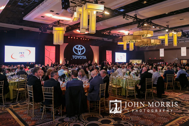 Large venue decorated and filled with diners at an Awards presentation and dinner for attendees during a corporate event at the Mandalay Bay Convention Center in Las Vegas