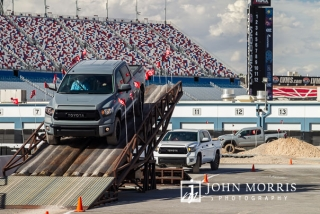 Trucks carrying event attendees through an exciting obstacle course in the infield of the Las Vegas Motor Speedway in Las Vegas as photographed by a San Diego Event Photographer