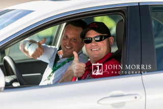 Attendees posing for the camera during a ride along at the Las Vegas Motor Speedway in Las Vegas as photographed by a San Diego Event Photographer
