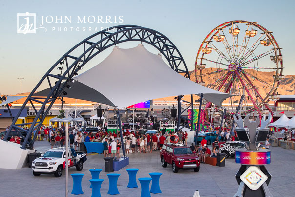 Elaborate setup for a corporate outing including a stage and ferris wheel in the infield at the Las Vegas Motor Speedway in Las Vegas as photographed by a San Diego Event Photographer