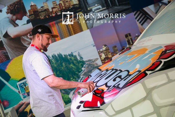 Artist creates colorful designs on an automobile during a demonstration at the Las Vegas Motor Speedway in Las Vegas as photographed by a San Diego Event Photographer