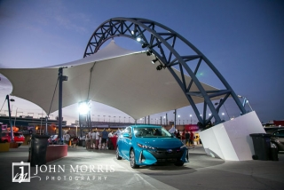 Balanced evening light with accent and spotlights of an automobile display during a corporate event and outing the Las Vegas Motor Speedway in Las Vegas as photographed by a San Diego Event Photographer