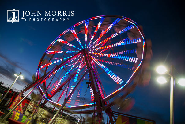 Ferris Wheel lit up at dusk during a corporate event and outing the Las Vegas Motor Speedway in Las Vegas as photographed by a San Diego Event Photographer