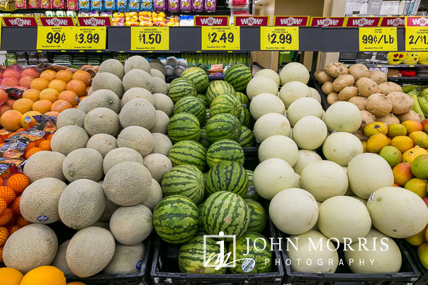 Colorful melon display during a professional event photographed at a grocery store grand opening in San Diego