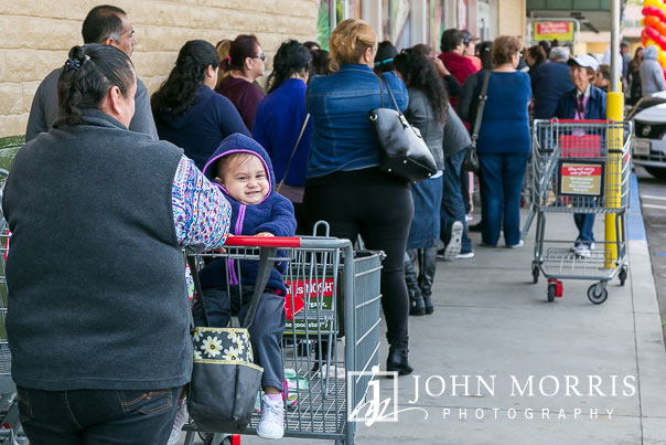Young Customer having fun during a professional event photographed at a grocery store grand opening in San Diego