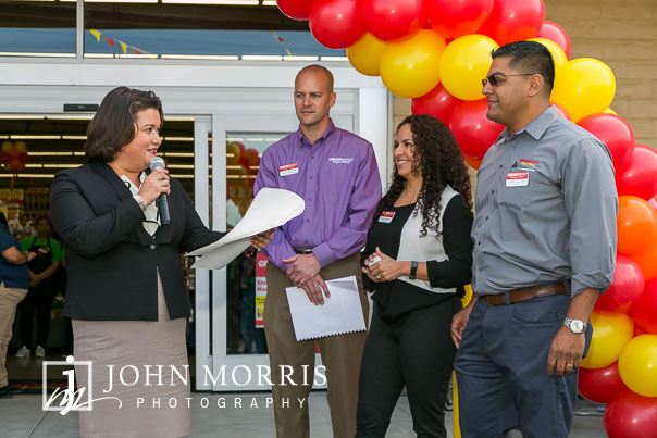 Dignitary presentation during a professional event photographed at a grocery store grand opening in San Diego