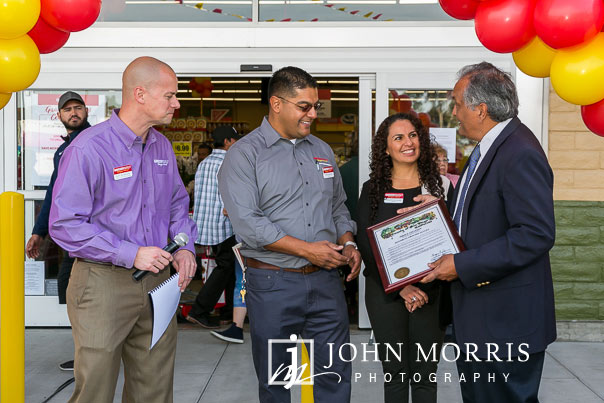 Chamber of Commerce presentation to owners during a professional event photographed at a grocery store grand opening in San Diego