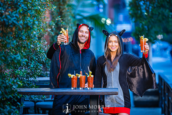 Halloween Fashion Fun with bat costumes and bloody marys at a bar